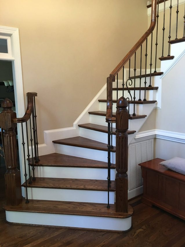 Wood staircase finished to match hardwood floors